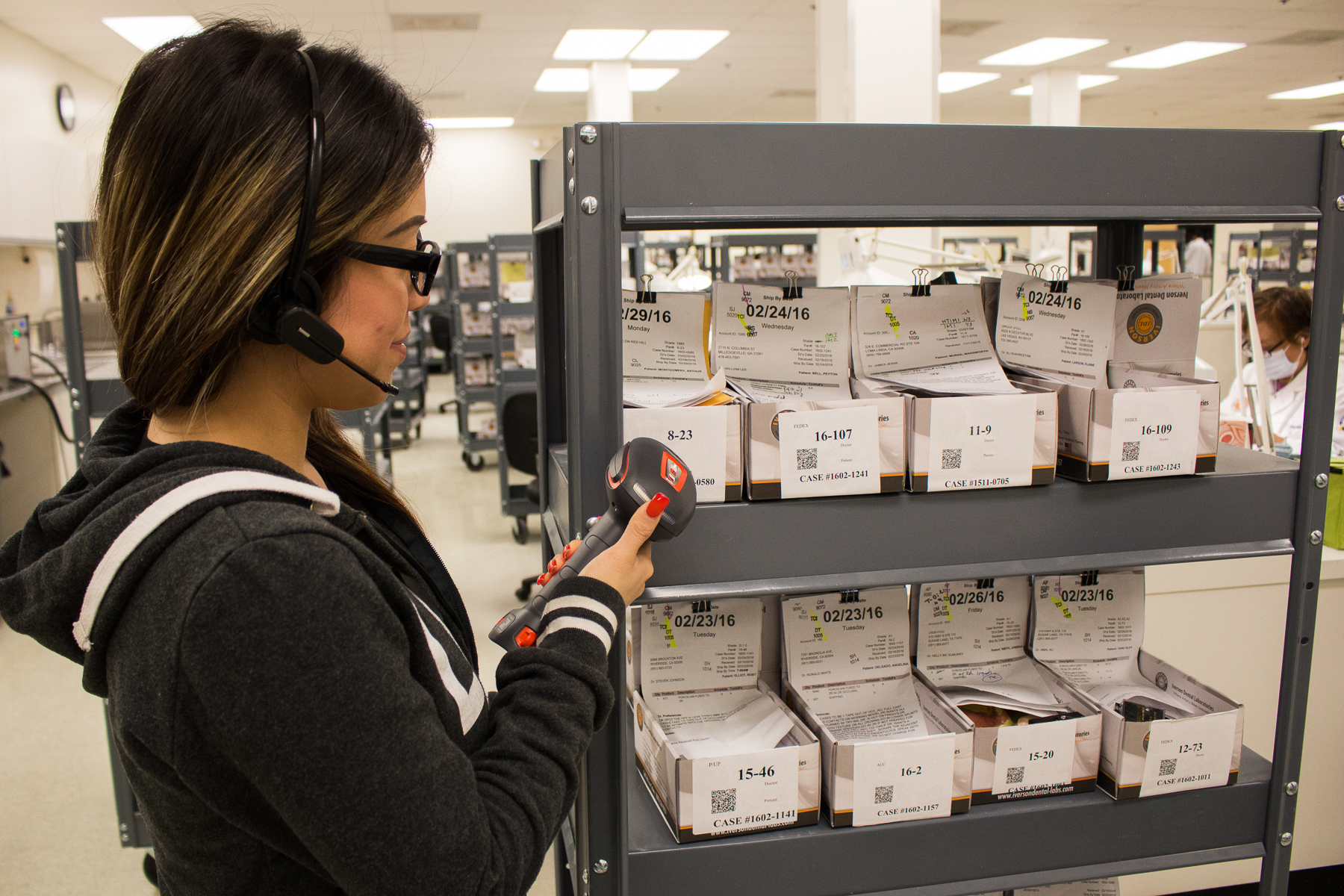 Dental cases are tracked and processed via QR codes by Iverson's logistics department